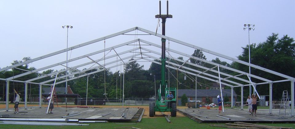 Erecting tents at US golf open, USA, 23 yrs old